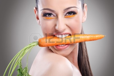 14332526-funny-image-of-woman-showing-carrot--healthy-lifestyle-people.