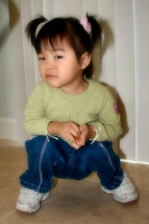 20061207_maddy_pigtails_squat.