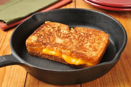 23667853-grilled-cheese-sandwich-in-a-cast-iron-skillet.