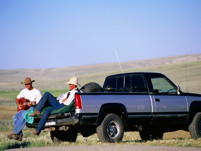 23683-6~Cowboy-Musicians-on-Back-of-Pick-Up-Truck-Near-South-Pass-Wyoming-Posters.