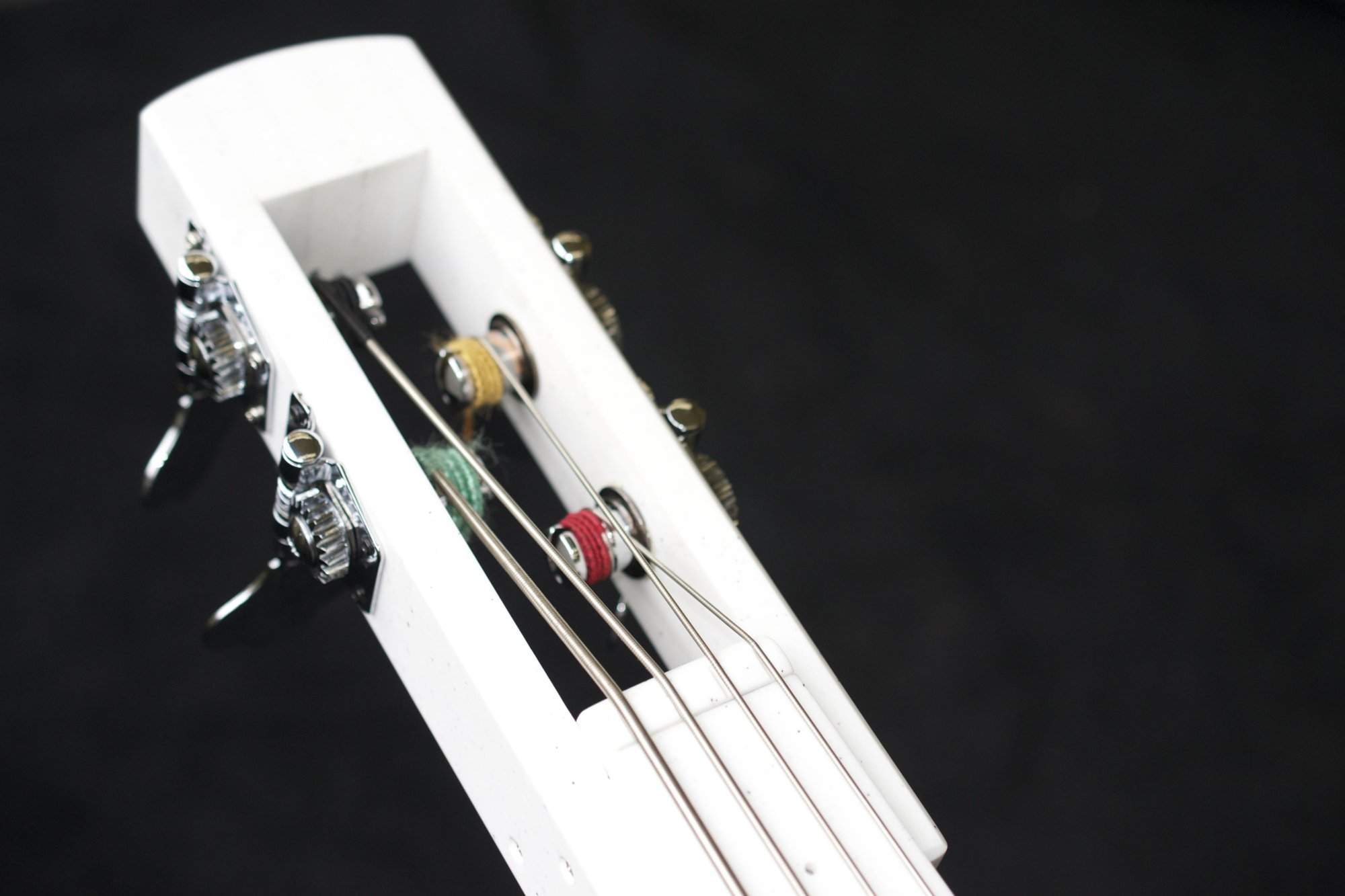 4 Headstock and nut with new strings.