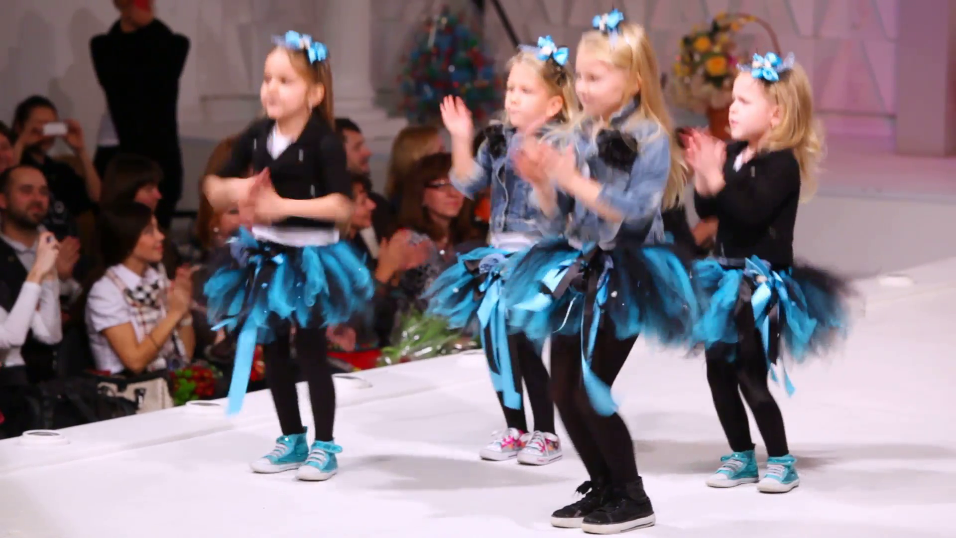 four-cute-little-girls-dancing-and-singing-on-the-stage_x1h3u3ocd__F0000.