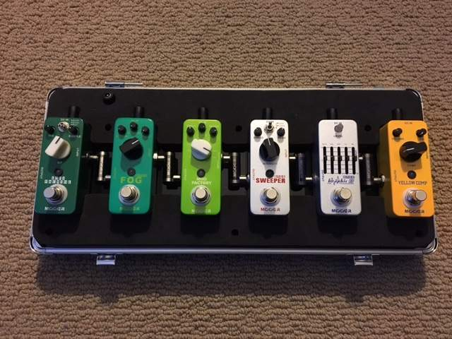 SOLD - 6 Mooer bass pedals w/firefly case/board, integrated
