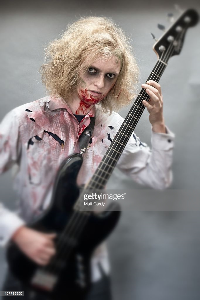 zombie-bass-guitar-player-ozzy-jackson-poses-for-a-photograph-prior-picture-id457765390.
